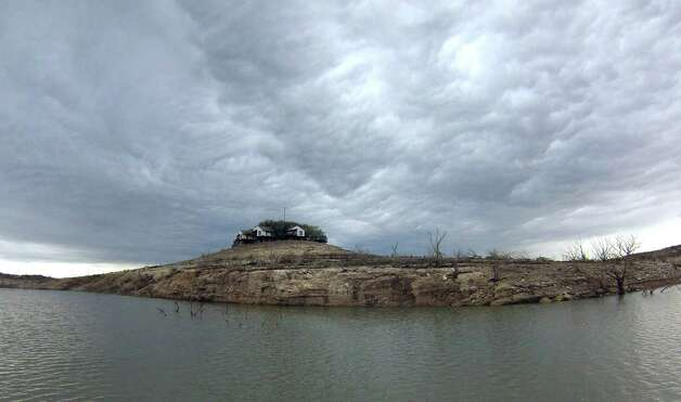 Rain clouds form over Medina Lake, which is about 80 feet below conservation pool due to drought, on Wednesday, April 3, 2013. Photo: Billy Calzada, San Antonio Express-News / San Antonio Express-News