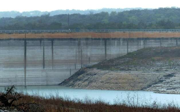 The Medina Lake Dam is marked by various water levels throughout its history. The lake is currently 80 feet below conservation pool due to drought. Wednesday, April 3, 2013. Photo: Billy Calzada, San Antonio Express-News / San Antonio Express-News