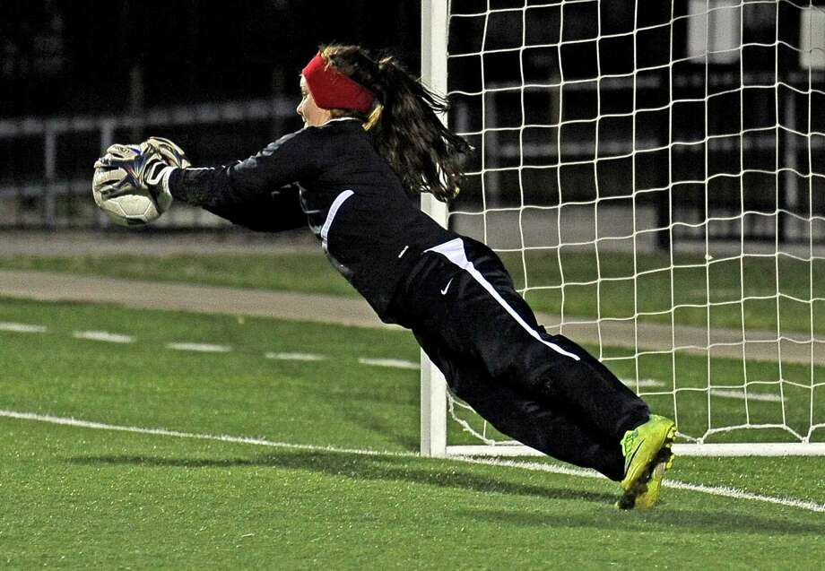 West Brook senior Stacy Dolan, #0, makes a save at the goal during the West Brook High School girls 5A area round soccer match against Clear Lake High School on Thursday, April 4, 2013, in Baytown. West Brook won over Clear Lake 5 - 4. Photo taken: Randy Edwards/The Enterprise Photo: Randy Edwards