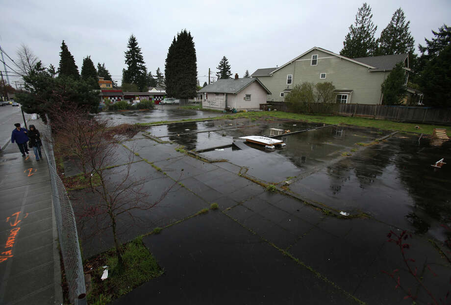 An empty lot is shown on the northwest corner of Roosevelt Way NE and NE 89th Street in Seattle's Maple Leaf neighborhood on Thursday, April 4, 2013. A lawsuit has been filed to stop development of the site. Photo: JOSHUA TRUJILLO / SEATTLEPI.COM