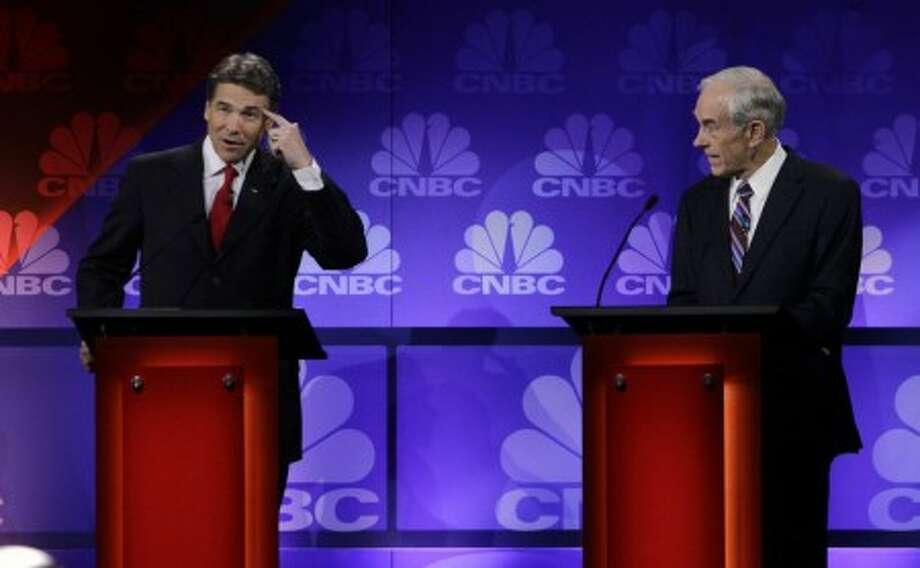 "And for a reality check: 2 percent of Texas Republicans think that Rick Perry should be their party's presidential nominee in 2016. Gotta give it to the lizard people.  Rick Perry at a 2012 Republican presidential debate. ""Oops.\"" (AP Photo)"