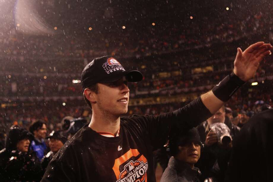 Buster Posey high fives a teammate after the San Francisco Giants\' victory in Game 7 of the NLCS  over the St. Louis Cardinals at AT&T Park Monday, October 22, 2012 in San Francisco, Calif. Photo: Pete Kiehart, The Chronicle / ONLINE_YES