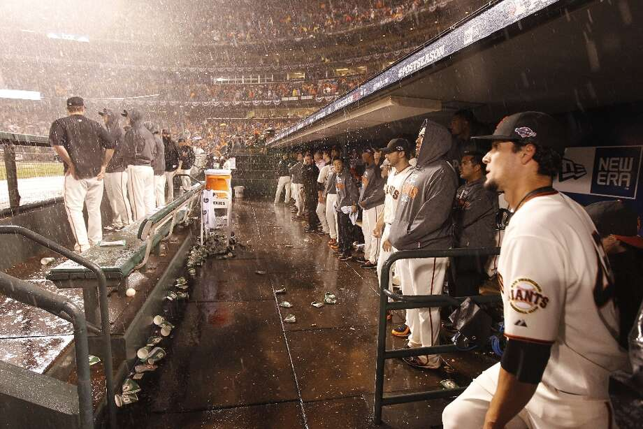 The Giants watch the end of the game as the rain poured down during game 7 of the NLCS at AT&T Park on Monday, Oct. 22, 2012 in San Francisco, Calif. Photo: Michael Macor, The Chronicle / ONLINE_YES