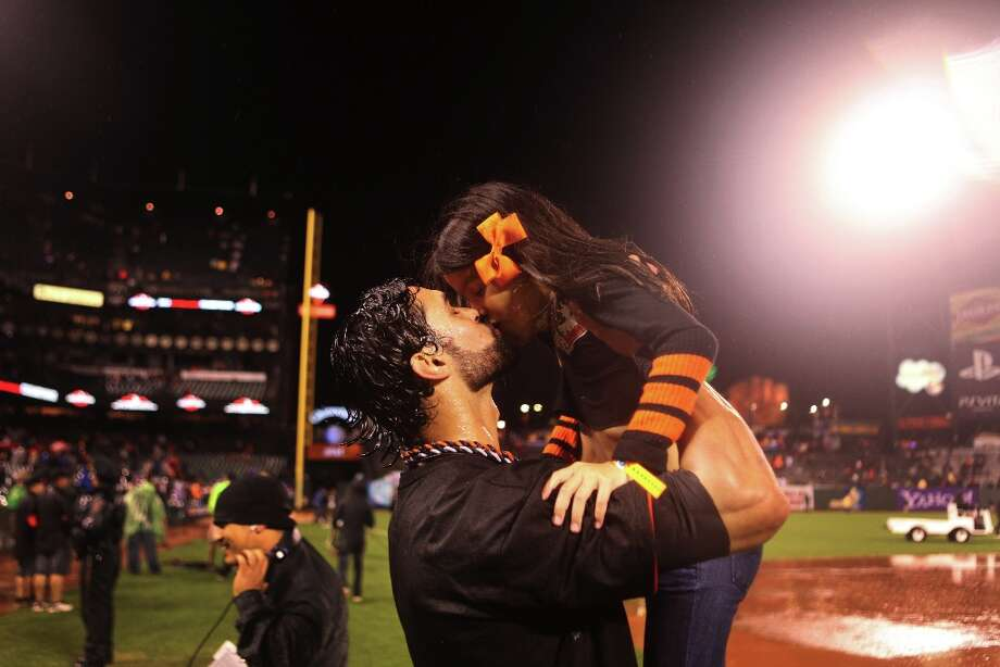Angel Pagan kisses one of his daughters after the San Francisco Giants\' victory in Game 7 of the NLCS  over the St. Louis Cardinals at AT&T Park Monday, October 22, 2012 in San Francisco, Calif. Photo: Pete Kiehart, The Chronicle / ONLINE_YES