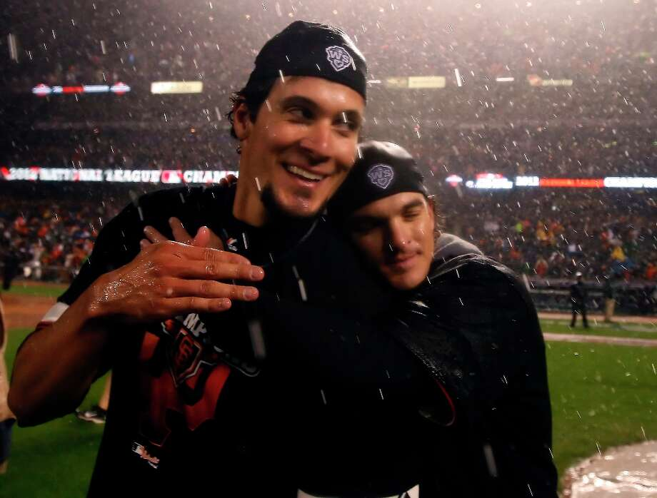San Francisco Giants pitcher Javier Lopez gets a hug from Ryan Theriot after the Giants defeated the St. Louis Cardinals in the 7th game of the NLCS Championship game at AT&T Park Monday, Oct. 22, 2012 in San Francisco, Calif. Photo: Lance Iversen, The Chronicle / ONLINE_YES