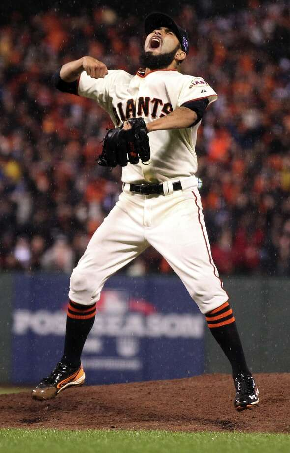 San Francisco Giants pitcher Sergio Romo celebrates the Giants NLCS Championship over the St. Louis Cardinals at AT&T Park Monday, Oct. 22, 2012 in San Francisco, Calif. Photo: Lance Iversen, The Chronicle / ONLINE_YES