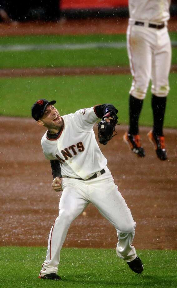 San Francisco Giants\' Marco Scutaro reacts after the final out in Game 7 of baseball\'s National League championship series against the St. Louis Cardinals Monday, Oct. 22, 2012, in San Francisco. The Giants won 9-0 to win the series. Photo: Mark Humphrey, Associated Press / AP