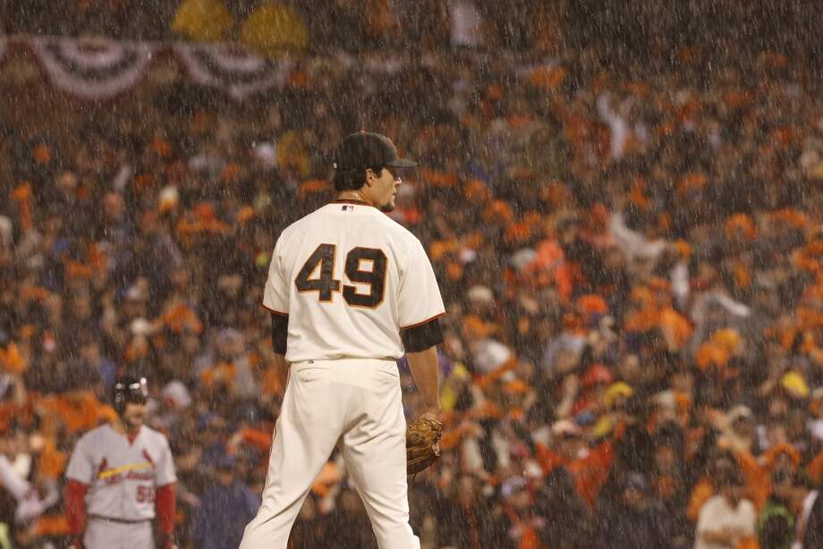 Giants\' pitcher Javier Lopez gets ready to pitch as the rain poured down during game 7 of the NLCS at AT&T Park on Monday, Oct. 22, 2012 in San Francisco, Calif. Photo: Michael Macor, The Chronicle / ONLINE_YES