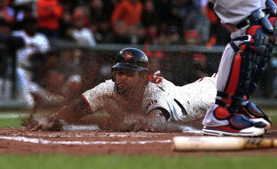 San Francisco Giants Angel Pagan reaches for home plate as he scores aianst the St. Louis Cardinals in their NLCS Championship game at AT&T Park Monday, Oct. 22, 2012 in San Francisco, Calif. Photo: Lance Iversen, The Chronicle / ONLINE_YES