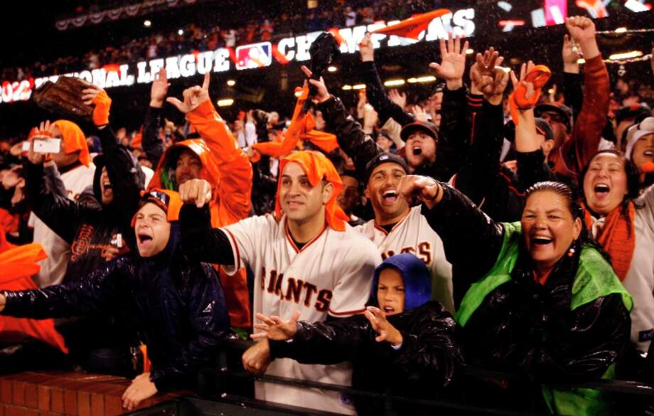 San Francisco Giants fans celebrate with the team after they defeated the St. Louis Cardinals for the NLCS Championship at AT&T Park Monday, Oct. 22, 2012 in San Francisco, Calif. Photo: Lance Iversen, The Chronicle / ONLINE_YES
