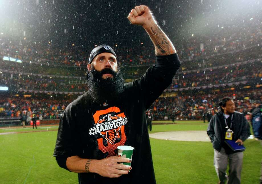 San Francisco Giants pitcher Brain Wilson cheers on his teammates after they defeated the St. Louis Cardinals for the NLCS Championship at AT&T Park Monday, Oct. 22, 2012 in San Francisco, Calif. Photo: Lance Iversen, The Chronicle / ONLINE_YES