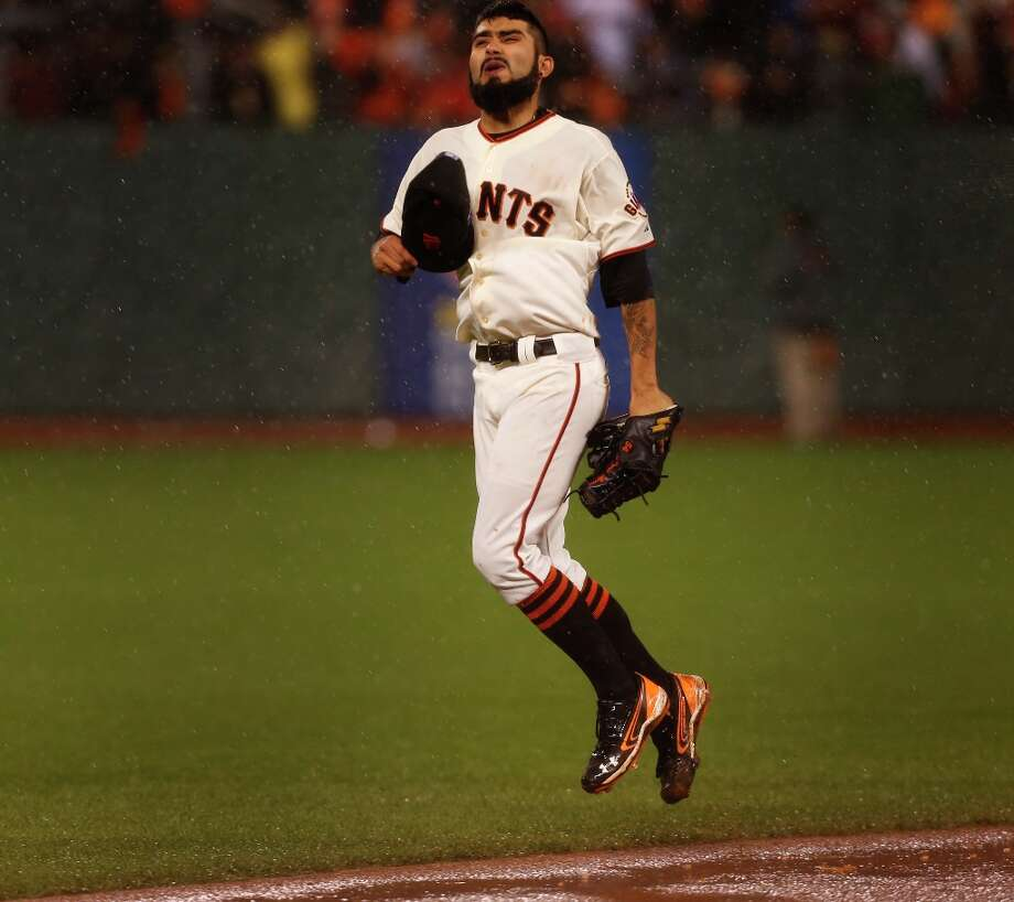 Sergio Romo celebrates the Giants\' 9-0 victory over the St. Louis Cardinals to advance to the World Series  during game 7 of the NLCS at AT&T Park on Monday, Oct. 22, 2012 in San Francisco, Calif. Photo: Michael Macor, The Chronicle / ONLINE_YES