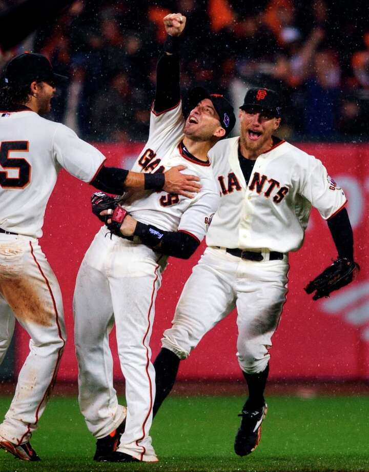 San Francisco Giants\' Marco Scutaro, center, celebrates with Hunter Pence, right, and Brandon Crawford after Scutaro made the final out of Game 7 of baseball\'s National League championship series against the St. Louis Cardinals, Monday, Oct. 22, 2012, in San Francisco. The Giants won 9-0. Photo: Randy Pench, Associated Press / The Sacramento Bee
