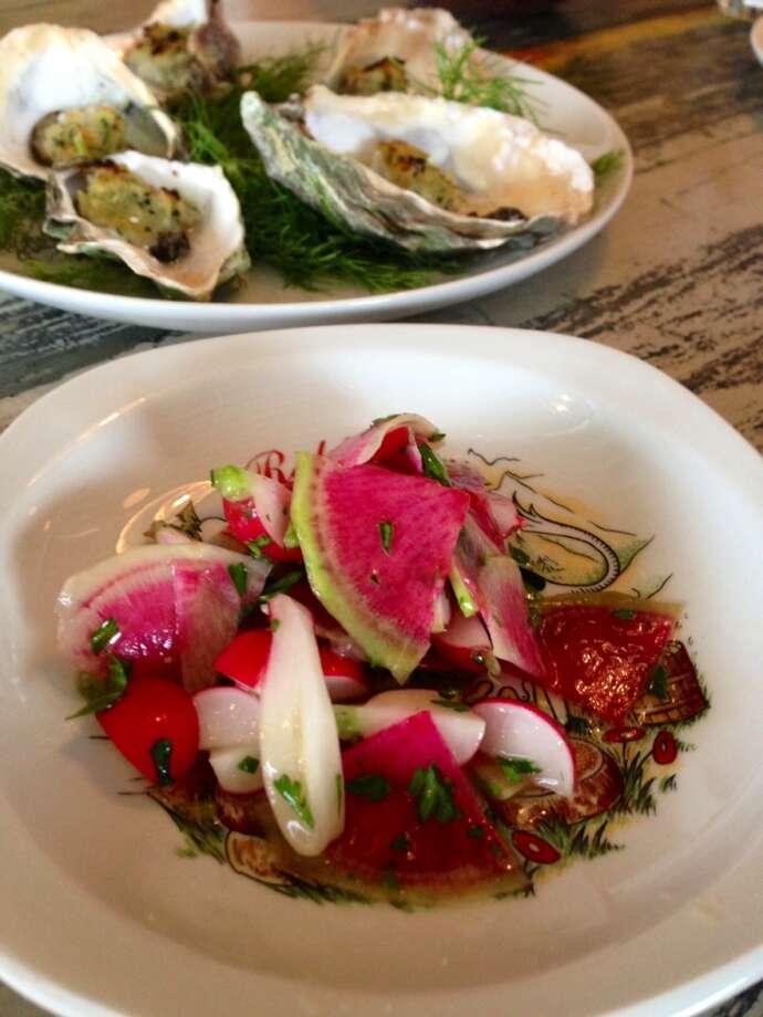 Wood-baked oysters and radish salad at Bantam in Santa Cruz
