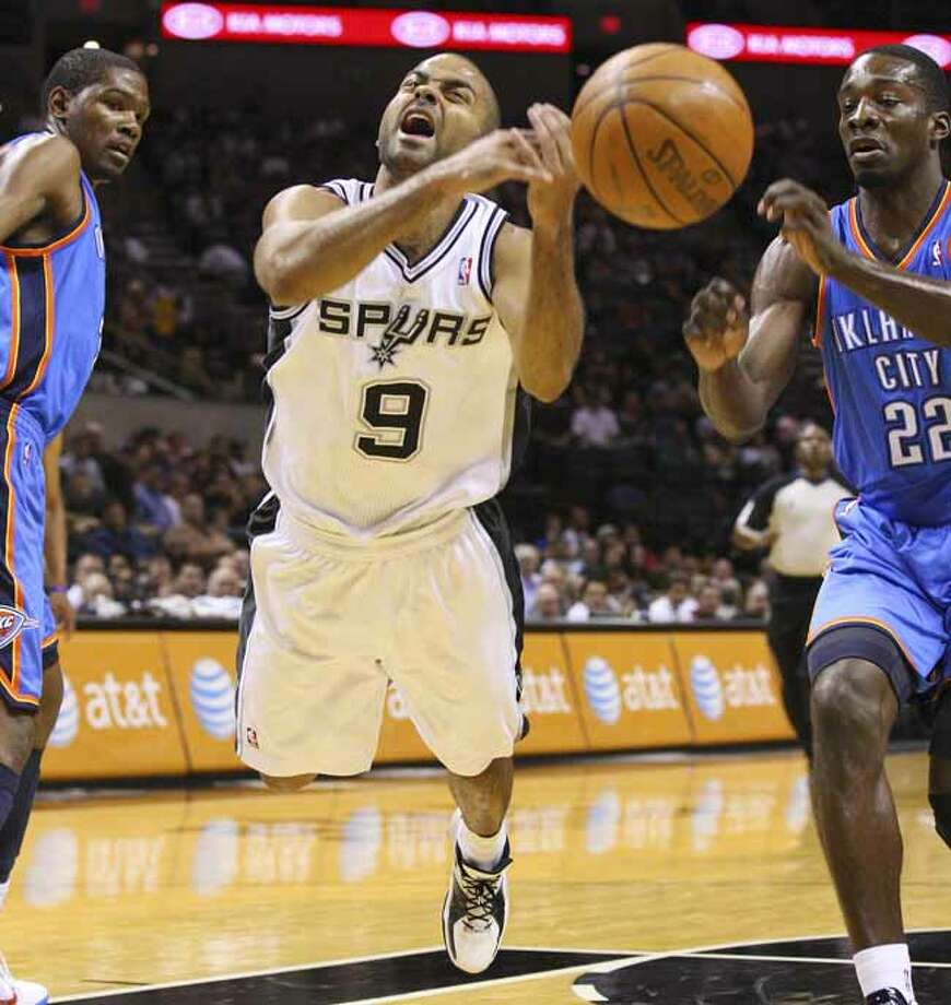 FOR SPORTS - Spurs' Tony Parker loses control of the ball between Thunder's Kevin Durant (left) and Jeff Green during first half action Monday Oct. 18, 2010 at the AT&T Center. (PHOTO BY EDWARD A. ORNELAS/eaornelas@express-news.net) Photo: EDWARD A. ORNELAS, SAN ANTONIO EXPRESS-NEWS / eaornelas@express-news.net