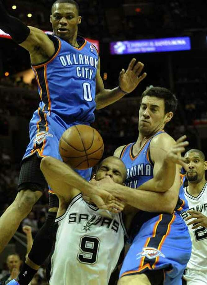 Tony Parker (9) of the San Antonio Spurs is fouled hard by Nick Collison, right, of the Oklahoma City Thunder as Russell Westbrook (0) defends during first-half NBA action at the AT&T Center on Wednesday, Feb. 23, 2011. A shoving match ensued after the play, with technical fouls being called. BILLY CALZADA / gcalzada@express-news.netOklahoma City Thunder at San Antonio Spurs Photo: BILLY CALZADA, SAN ANTONIO EXPRESS-NEWS / gcalzada@express-news.net