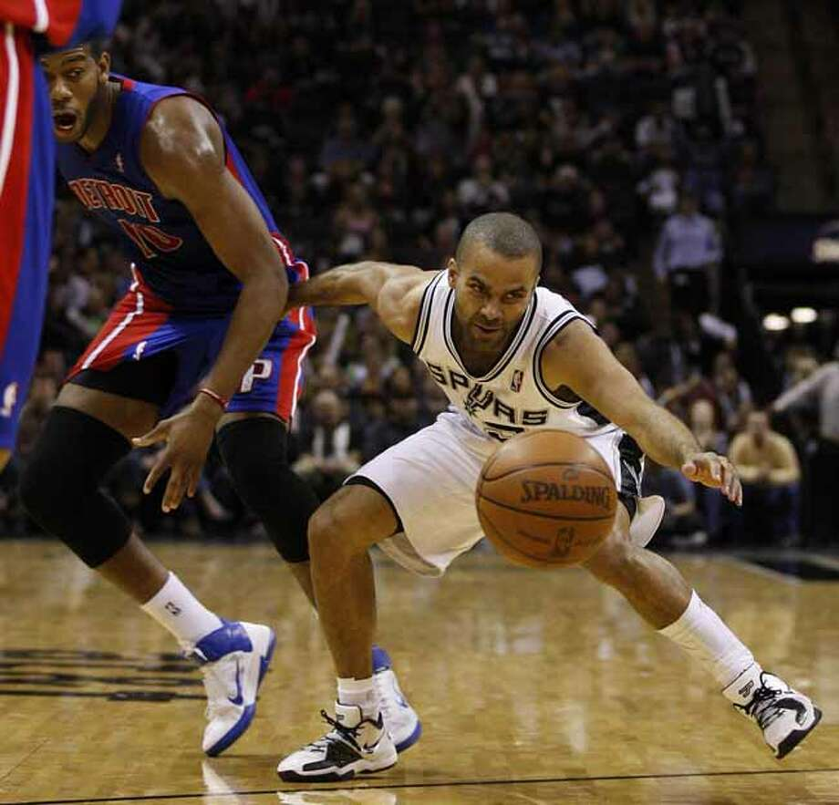 SPURS -- San Antonio Spurs Tony Parker keeps the loose ball away from Detroit Pistons Greg Monroe in the second half at the AT&T Center, Wednesday, March 9, 2011. The Spurs won 111-104. JERRY LARA/glara@express-news.net Photo: JERRY LARA, San Antonio Express-News / SAN ANTONIO EXPRESS-NEWS (NFS)