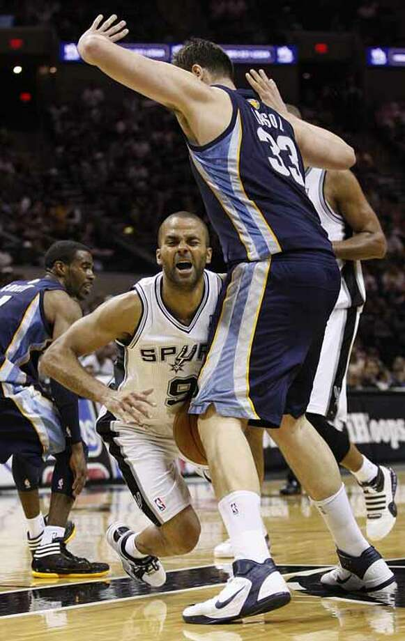 SPURS -- San Antonio Spurs Tony Parker loses his balance as Memphis Grizzlies Marc Gasol defends during the second half of game one in the NBA Western Conference First Round at the AT&T Center, Sunday, April 17, 2011. The Grizzlies won 101-98.JERRY LARA/glara@express-news.net Photo: JERRY LARA, San Antonio Express-News / SAN ANTONIO EXPRESS-NEWS (NFS)