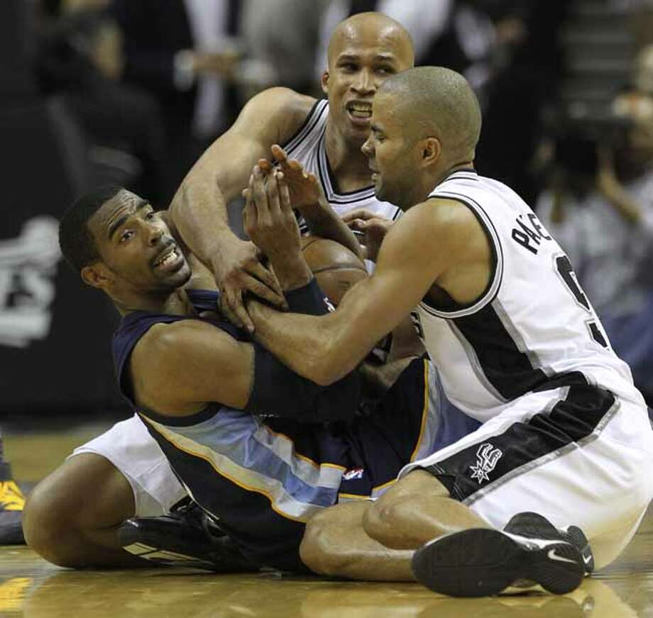 Memphis Grizzlies guard Mike Conley (11) tries to call a timeout while tangled up with San Antonio Spurs forward Richard Jefferson (24) and San Antonio Spurs guard Tony Parker (9) in Game 5 of the first round of the Western Conference playoff at the AT&T Center on Wednesday, April 27, 2011. Kin Man Hui/kmhui@express-news.net Photo: KIN MAN HUI, SAN ANTONIO EXPRESS-NEWS / San Antonio Express-News NFS