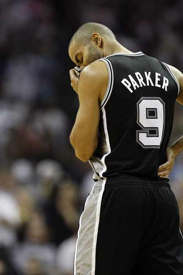 SPURS -- San Antonio Spurs Tony Parker looks down as they go on to lose to the Memphis Grizzlies 99-91 ib game six of the Western Conference First Round at FedExForum, Friday, April 29, 2011. JERRY LARA/glara@express-news.net Photo: JERRY LARA, San Antonio Express-News / SAN ANTONIO EXPRESS-NEWS (NFS)