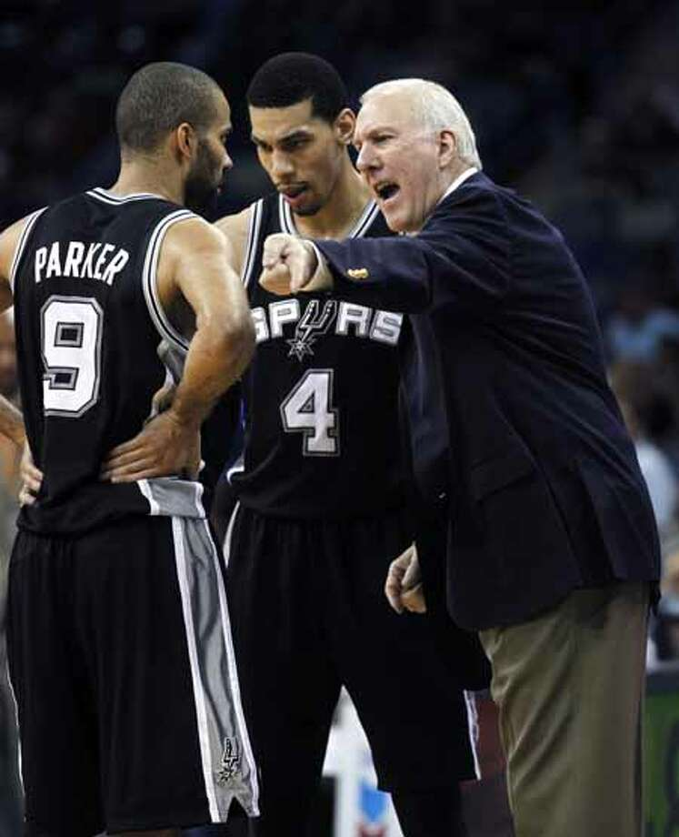 San Antonio Spurs coach Gregg Popovich talks to point guard Tony Parker (9) and guard Daniel Green (4) in the second half of an NBA basketball game in New Orleans, Monday, Jan. 23, 2012. The Spurs won 104-102. Photo: AP