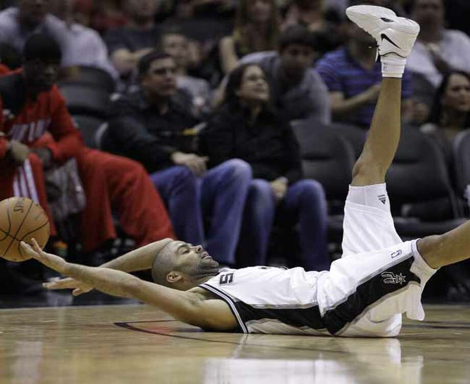 San Antonio Spurs' Tony Parker, of France, falls to the floor as he chases a loose ball during the third quarter of an NBA basketball game against the Portland Trail Blazers, Monday, April 23, 2012, in San Antonio. San Antonio won 124-89. Photo: AP