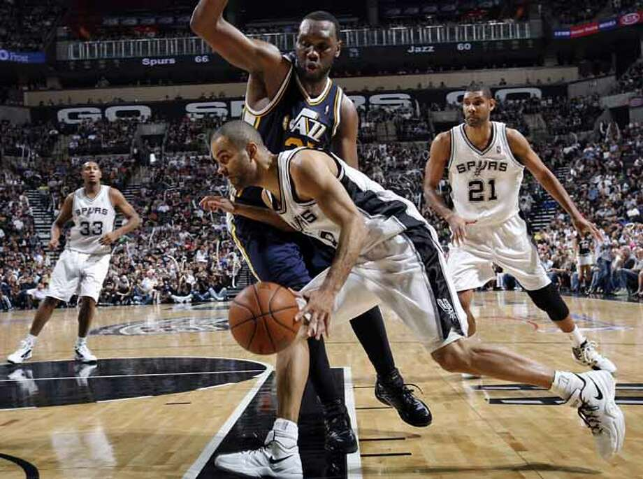 FOR SPORTS - San Antonio Spurs Tony Parker looks for room around Utah Jazz Al Jefferson during second half action of Game 1 of the Western Conference first round Sunday April 29, 2012 at the AT&T Center. The Spurs won 106-91. Photo: EDWARD A. ORNELAS, SAN ANTONIO EXPRESS-NEWS / © SAN ANTONIO EXPRESS-NEWS (NFS)