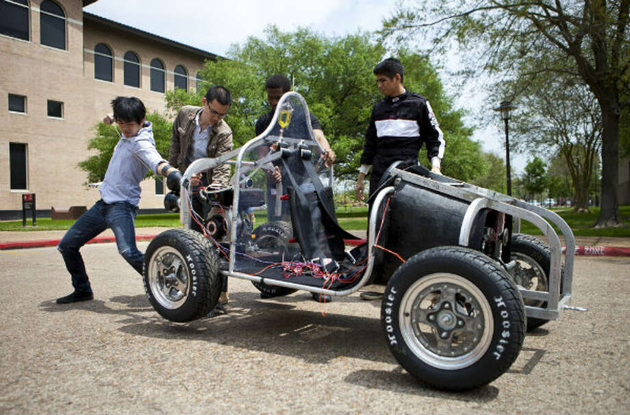 Brian Liu, a University of Houston student, starts up a vehicle he and his teammates plan to enter in the Shell Eco-Marathon. The marathon is a contest evaluating fuel efficiency and innovative design. Team Gladius' vehicle runs on bio-diesel called B-100 from Shell. Photo: Nick De La Torre, Houston Chronicle