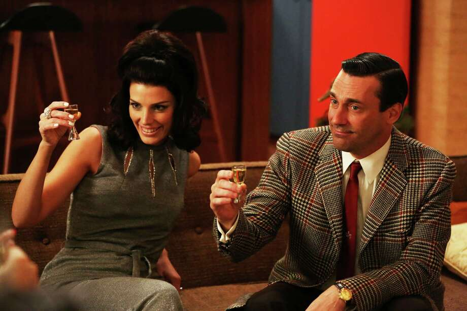 "Megan (Jessica Paré) and Don Draper (Jon Hamm) are still together in Season 6 of ""Mad Men."" Series creator Matthew Weiner says he plans one more season for the 1960s drama. Photo: Michael Yarish, HOEP / AMC"
