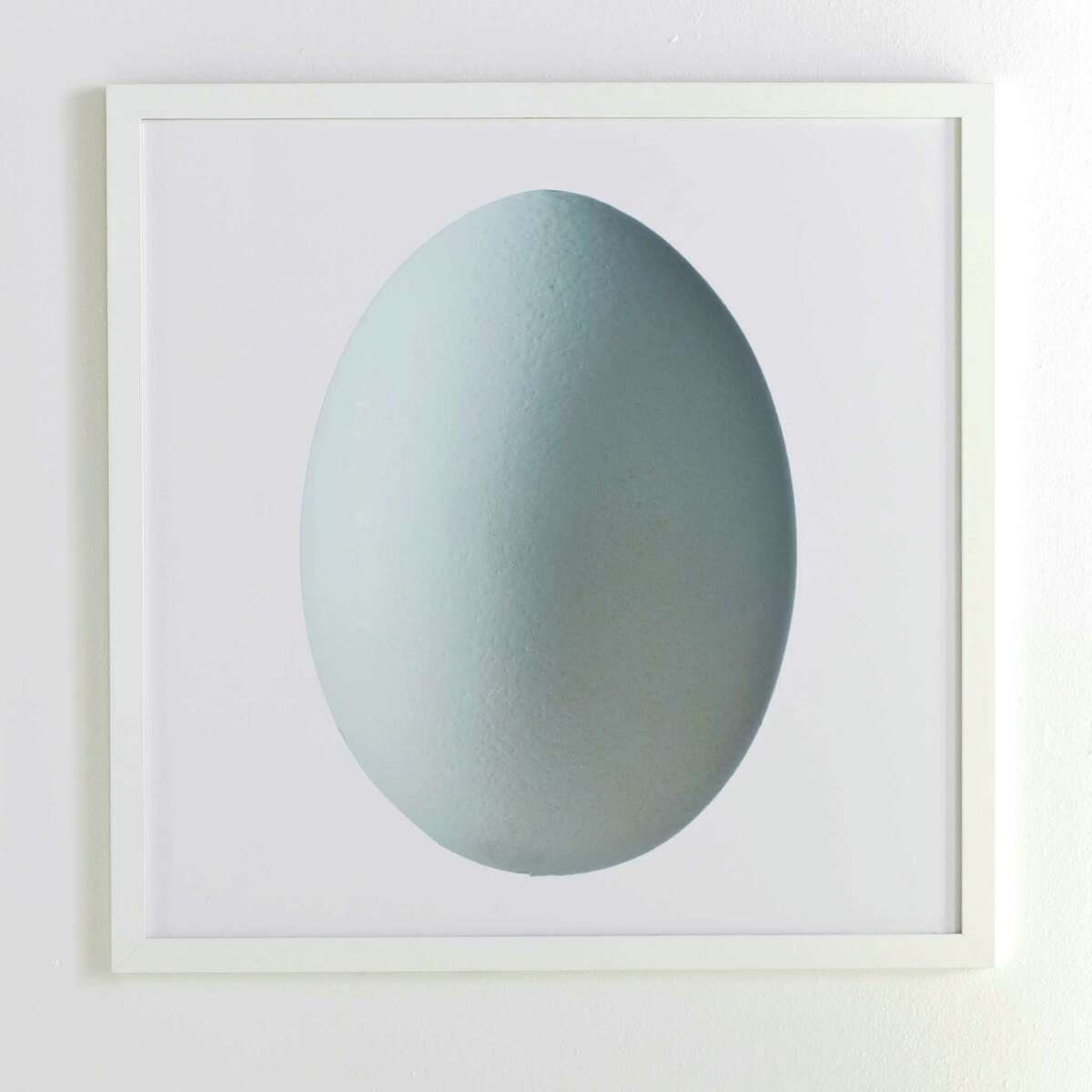 This undated publicity photo provided by Wisteria shows a dramatic rendering of a blue egg that makes a beautiful statement on a wall. Artistic elements in wall art, soft furnishings and tabletop are a strong spring décor trend this year )www.wisteria.com). (AP Photo/Wisteria)