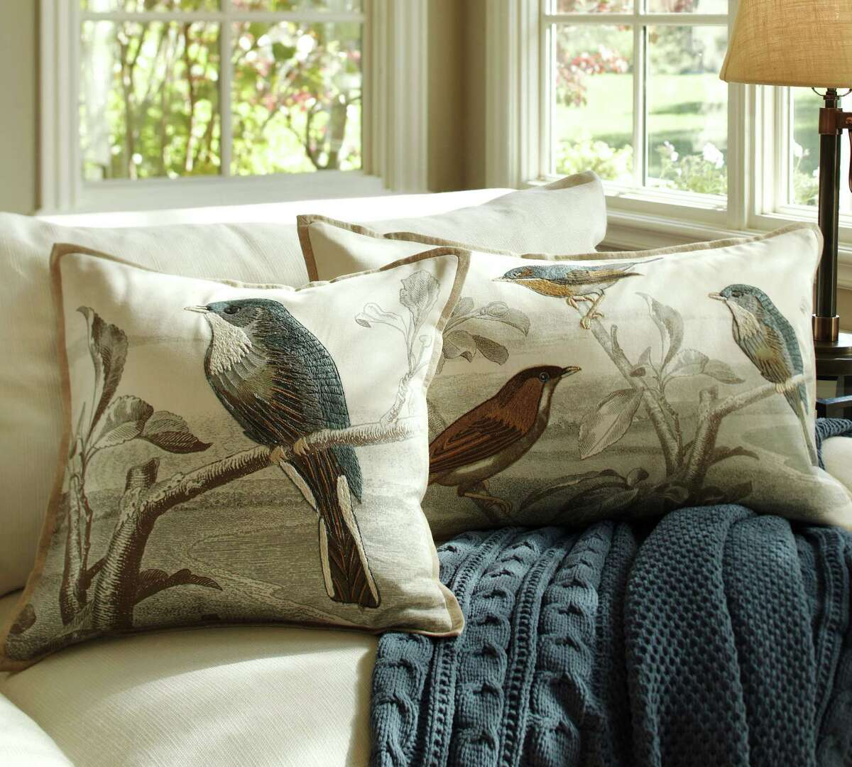 This publicity image provided by Pottery Barn shows Sky Bird embroidered pillow covers from Pottery Barn. Visiting this spring's decor previews often felt like exploring an art gallery. There was an artistic vibe in everything from dinnerware to drapery, art photographs to textiles. (AP Photo/Pottery Barn)