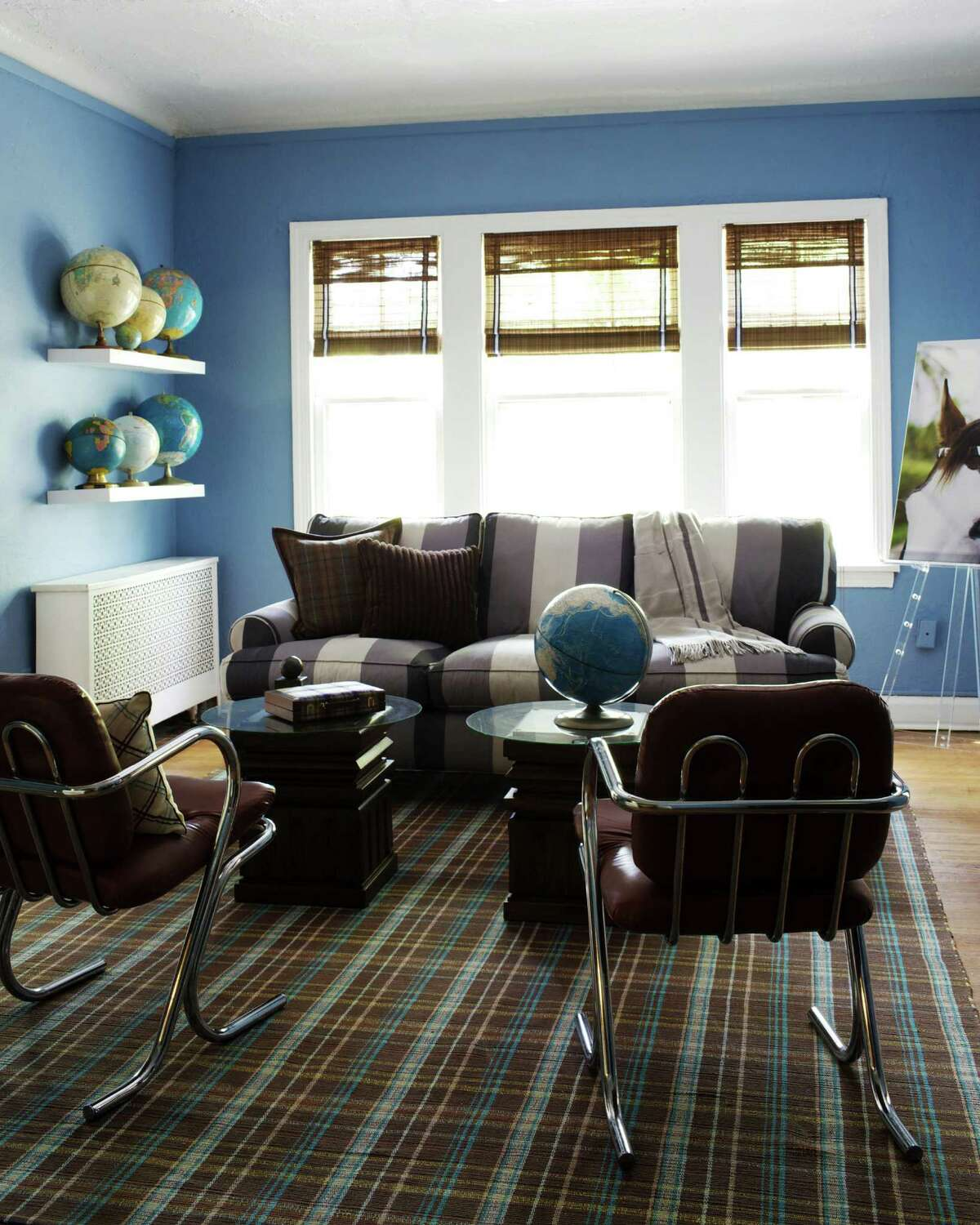 """In this undated publicity photo provided by courtesy Kyle Schuneman, a bold sofa pattern and plaid carpet add personality to a rented apartment in this design by Kyle Schuneman, as seen in """"The First Apartment Book: Cool Design for Small Spaces,"""" by Kyle Schuneman (Potter Style, 2012). (AP Photo/Courtesy Kyle Schuneman, Joe Schmelzer)"""