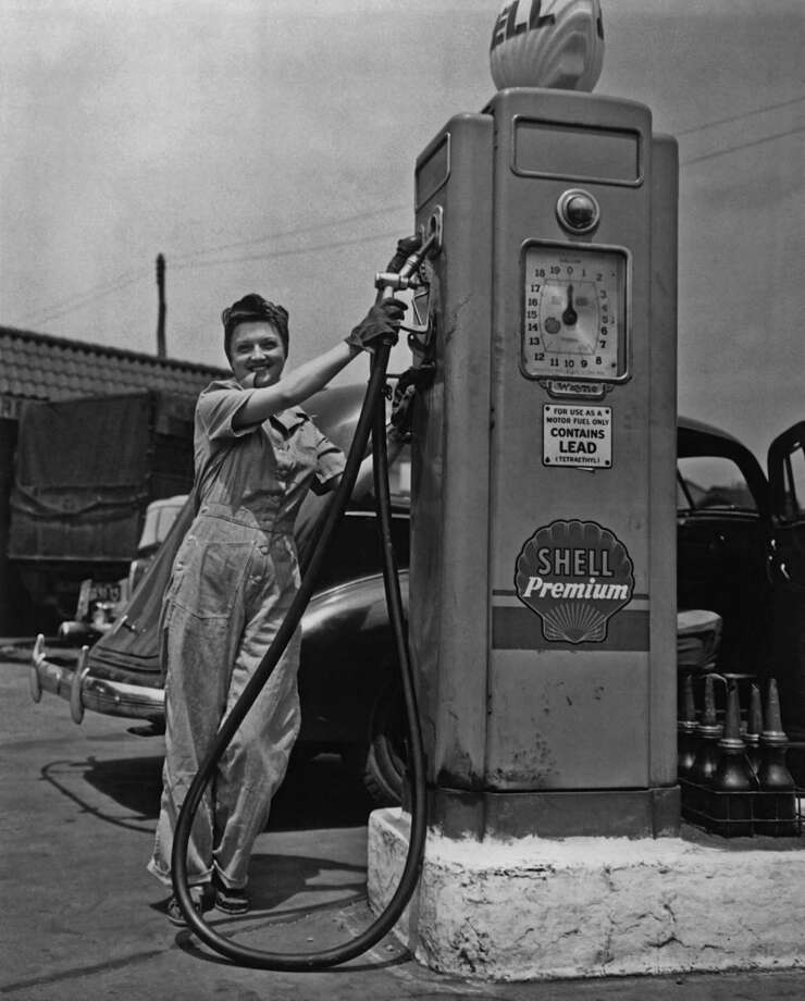 Overalls are nothing if not practical: Here an overall-wearing woman pumps gas in New York City in 1975. Photo: FPG, Getty Images / 2011 Getty Images