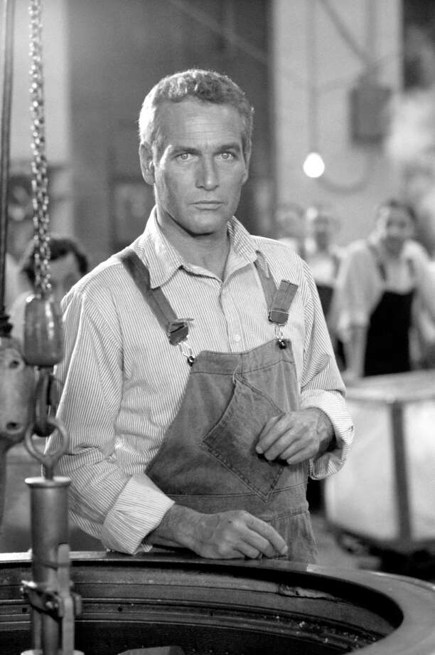 As blue jeans turn 160-years-old, we begin a look back at overalls. Here, Paul Newman filming The Mackintosh Man makes them utilitarian demin look pretty darn manly. Photo: Terry O'Neill, Getty Images / Firepine Ltd