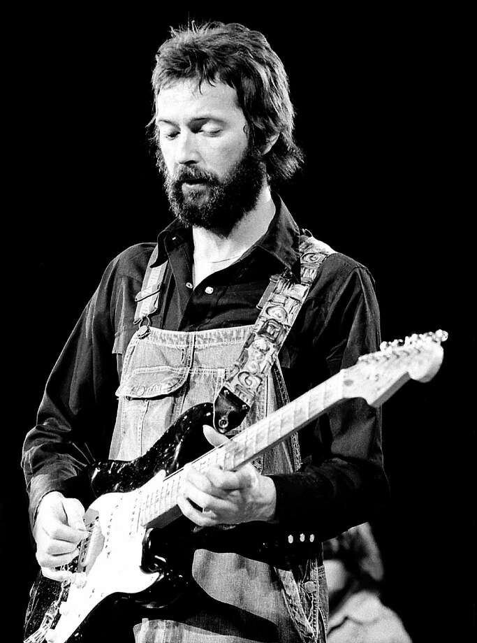 Eric Clapton; performing live onstage, playing his 'Blackie' Fender Stratocaster, in 1974. Photo: Robert Knight Archive, Getty Images / Redferns