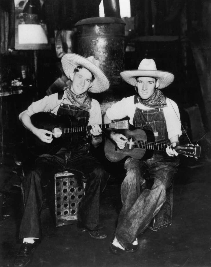 Country music duo the Delmore Brothers were O.G. overall wearers. Photo: Frank Driggs Collection, Getty Images / 2003 Getty Images