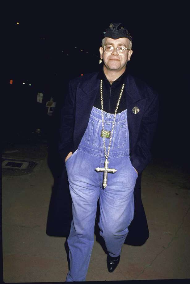 Elton John wearing overalls and a large cross necklace. Photo: Time Life Pictures, Getty Images / Time Life Pictures