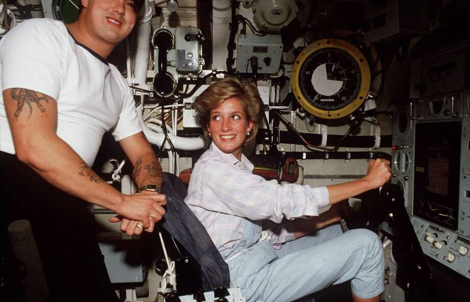 She also wore them, appropriately, aboard the submarine HMS Trafalgar. Photo: Tim Graham, Getty Images / Tim Graham Photo Library