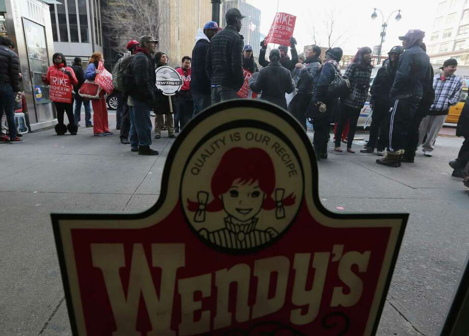 NEW YORK, NY - APRIL 04:  Fast food workers and supporters protest for better wages outside a Wendy's restaurant in Manhattan on April 4, 2013 in New York City. Organizers said hundreds of fast food workers were expected to walk off the job today from establishments including Wendy's, McDonald's and KFC to rally for better pay and union rights. Photo: Mario Tama, Getty Images / 2013 Getty Images