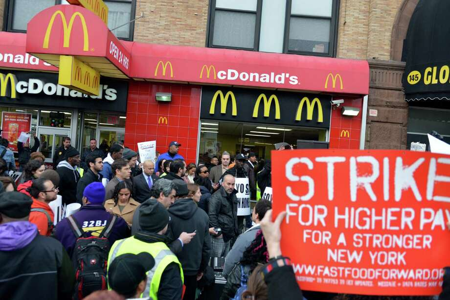 A coalition of groups rally in front of a McDonald's on East 125th Street and Lexington Avenue in Harlem during a protest by fast food workers and supporters for higher wages April 4, 2013 in New York. The protest was held on the 45th anniversary of the assasination of civil rights leader Martin Luther King, Jr. AFP PHOTO/Stan HONDASTAN HONDA/AFP/Getty Images Photo: STAN HONDA, AFP/Getty Images / AFP