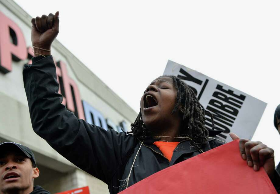 A woman shouts slogans as she joins a march to a McDonald's in Harlem during a protest by fast food workers and supporters for higher wages April 4, 2013 in New York. The protest was held on the 45th anniversary of the assasination of civil rights leader Martin Luther King, Jr. AFP PHOTO/Stan HONDASTAN HONDA/AFP/Getty Images Photo: STAN HONDA, AFP/Getty Images / AFP