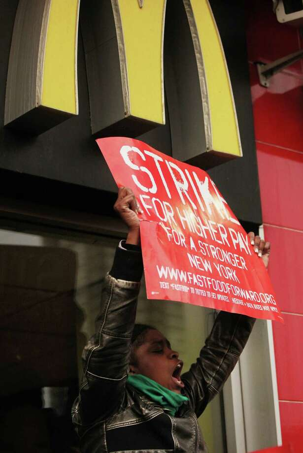 NEW YORK, NY - APRIL 04:  A demonstrator yells during a protest for better wages for fast food workers outside a McDonald's restaurant in Harlem on April 4, 2013 in New York City. Organizers said hundreds of fast food workers were expected to walk off the job today from establishments including Wendy's, McDonald's and KFC to rally for better pay and union rights. Photo: Mario Tama, Getty Images / 2013 Getty Images
