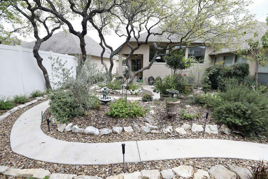 Peter and Renate Grasser's garden home in Stone Oak is one of 18 homes and businesses featured on the Solar San Antonio home tour, set for Saturday. Photo: Photos By Edward A. Ornelas / San Antonio Express-News