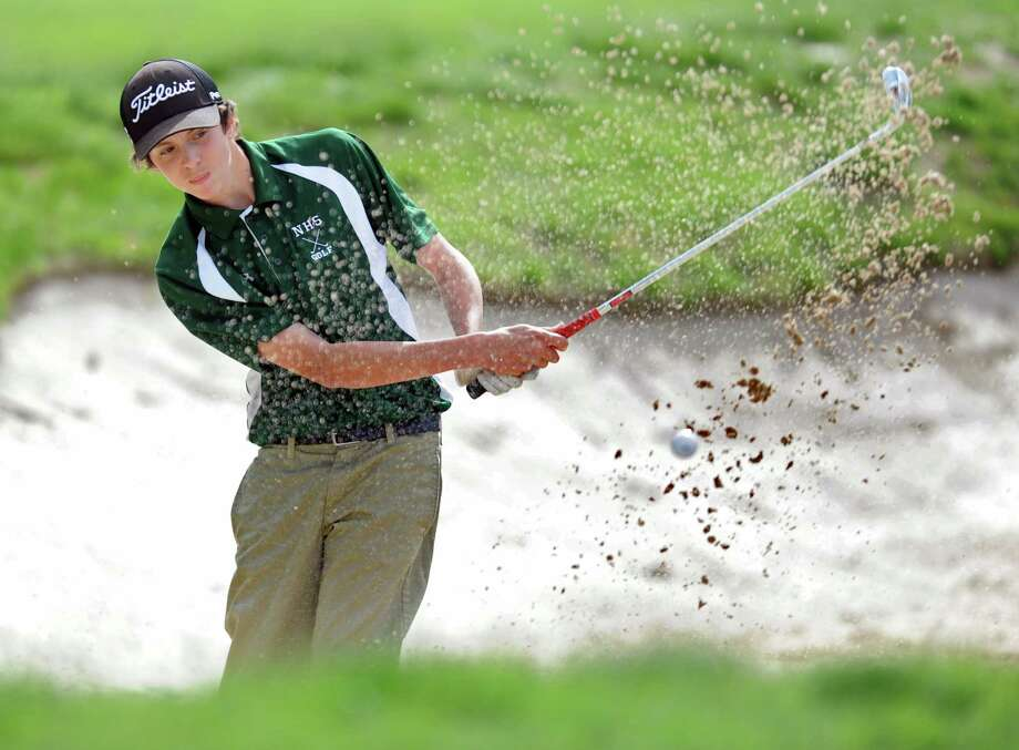 Norwalk's James Henderson hits it out of the sand at Longshore Golf Course in Westport during a meet with Staples High School Thursday, May 10, 2012. Photo: Autumn Driscoll / Connecticut Post