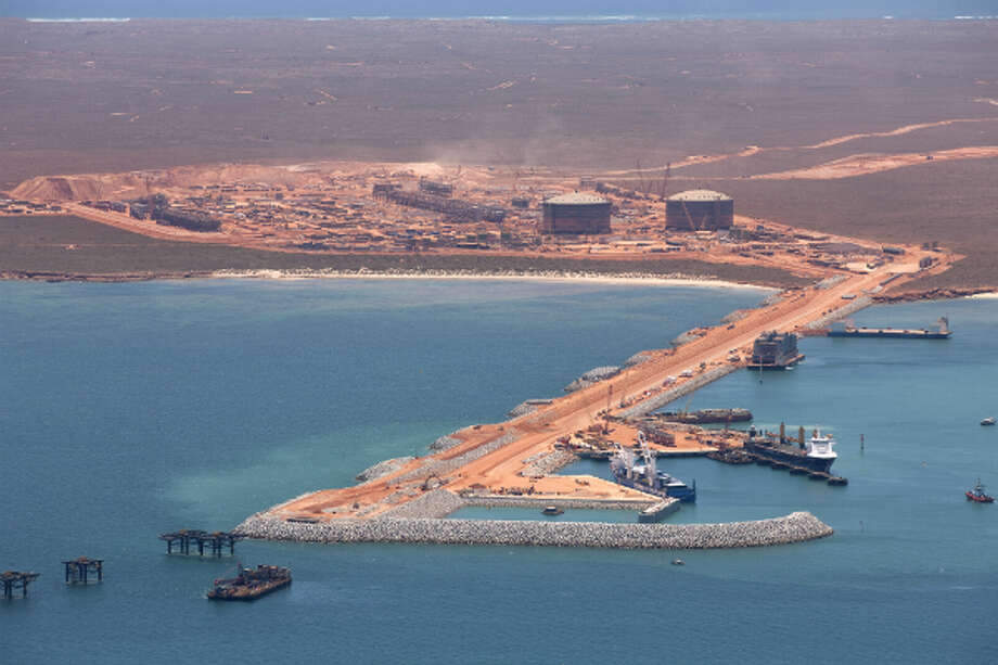 1. Australia  Foreign workers: 2014 -- $164,000 2013 -- $171,000   Local workers: 2014 -- $163,700 2013 -- $163,600   [Photo: Chevron's Gorgon LNG projectt, located on Barrow Island off of Australia's west coast, is expected to be up and running in 2014. The facility will produce 450,000 barrels of oil equivalent per day.] Photo: Chevron