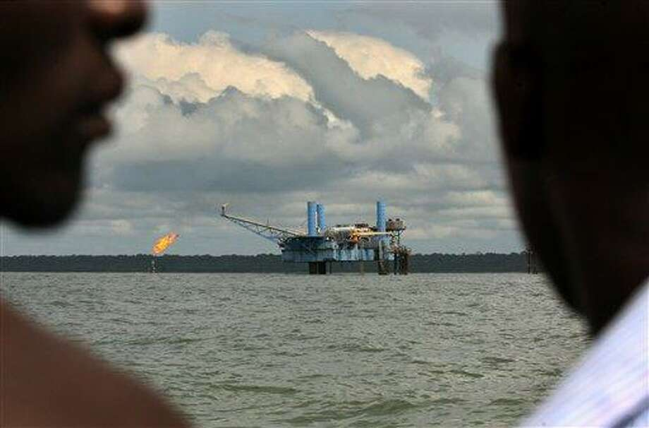 9. Nigeria  Foreign workers: 2014 -- $129,800 2013 -- $140,800   Local workers: 2014 -- $48,500 2013 -- $55,100   [Photo: Local youths look at an oil rig belonging to Conoil PLC in Sangana, Nigeria's oil-rich delta region, in 2006.] Photo: George Osodi, AP / AP