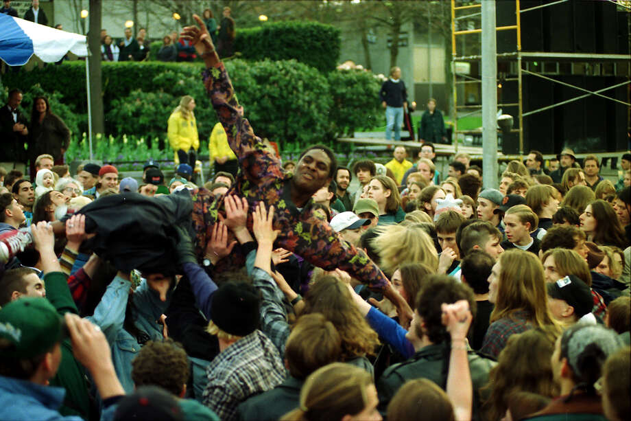 This previously unpublished image shows a young man crowd surfing at the April 10, 1994, memorial for Kurt Cobain. Photo: P-I Staff Photographer/Copyright MOHAI, Seattle Post-Intelligencer Collection, 2000.107_19940410_0068.