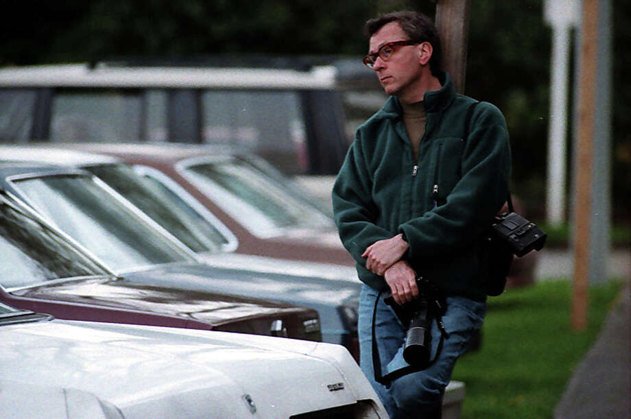 A photographer is shown outside an April 1994 memorial for Kurt Cobain. This image has not previously been published. Photo: P-I Staff Photographer/Copyright MOHAI, Seattle Post-Intelligencer Collection, 2000.107_19940410_0121.