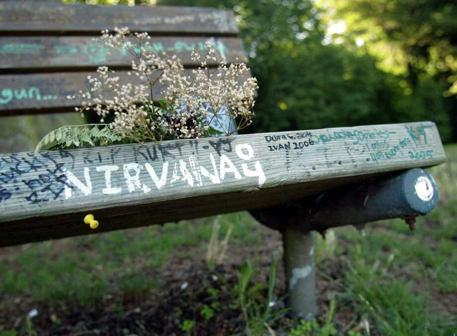 The bench next to Kurt Cobain's former home has become a landmark for fans. Photo: Joshua Trujillo/seattlepi.com