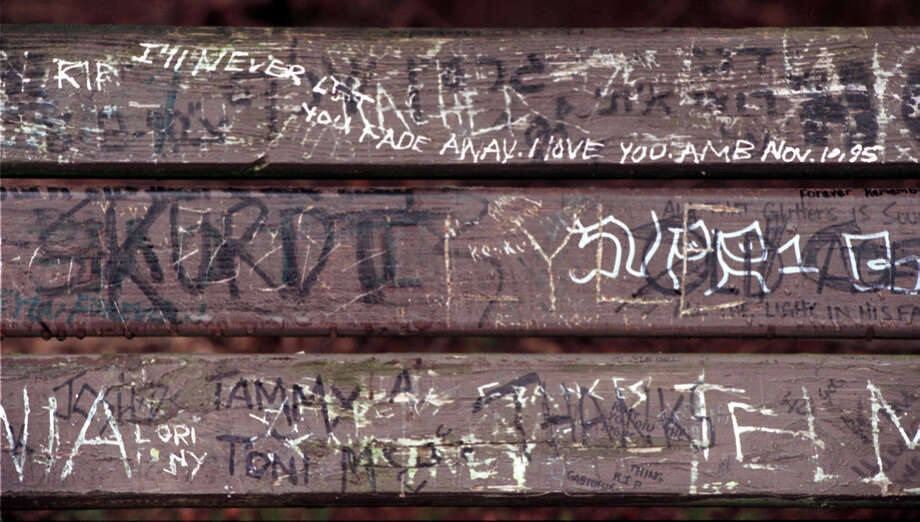 Fans of Kurt Cobain have been leaving painted and carved messages on the back of a bench in Viretta Park next his former home at 171 Lake Washington Blvd. E. This picture was taken March 17, 1997. Photo: Grant M. Haller/Seattlepi.com File